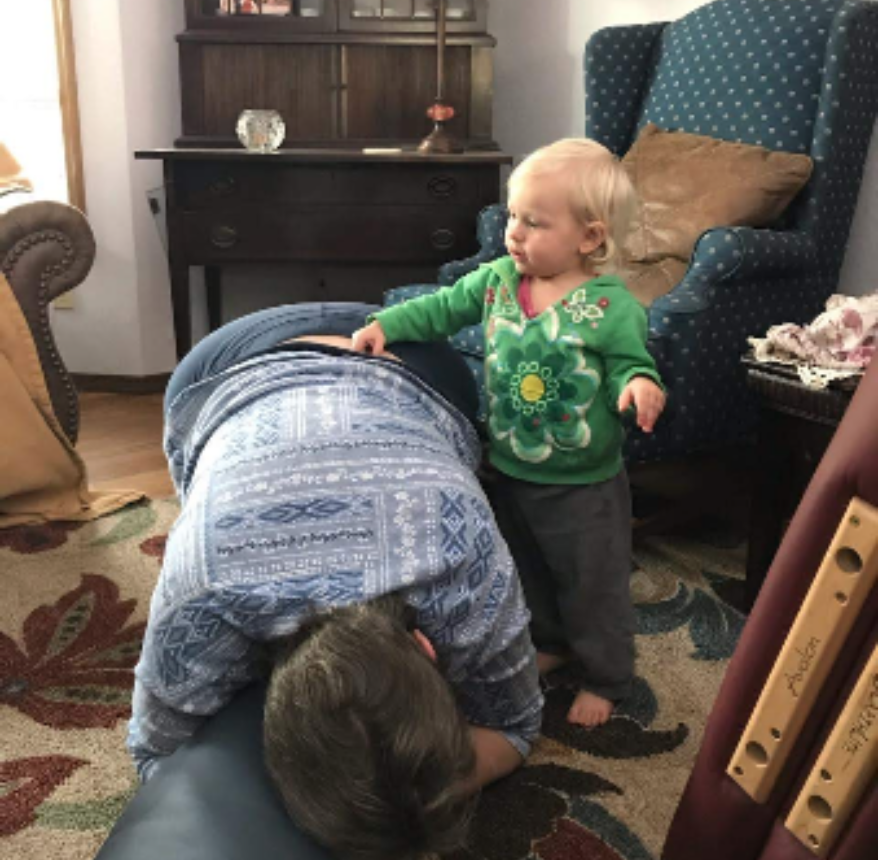 21-month-old Jasmine Mallant performing lower back moves on great-aunt Misty Williams
