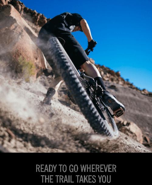 Mountain Biker skidding in dirt wearing Ventana Fastlace shoes