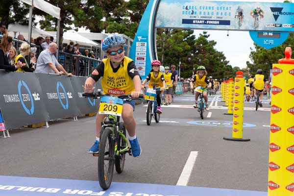 A happy little Vegemite crosses the finish line
