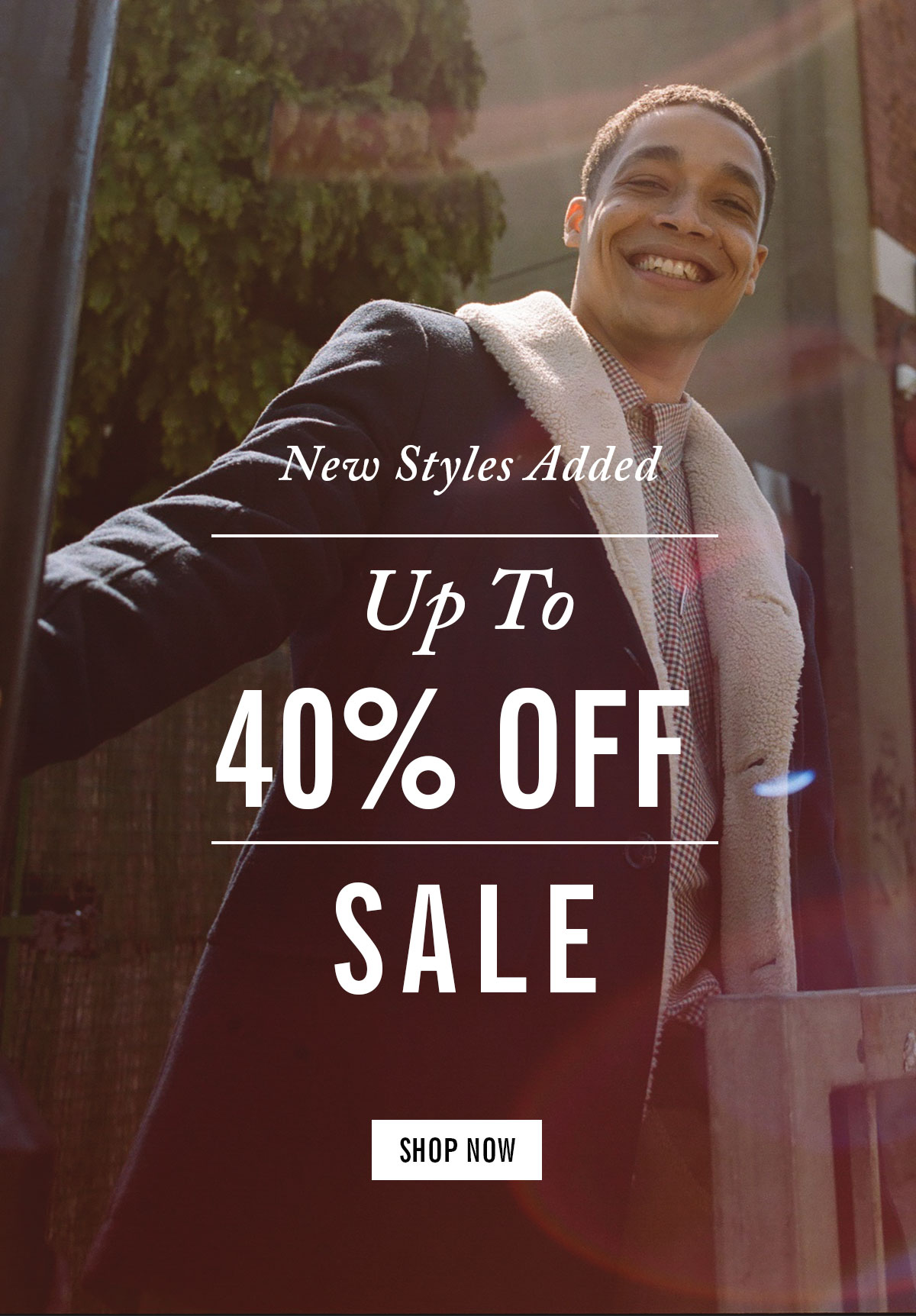 New Styles Added | Up to 40% Off | Sale | Photo of a man in a button-down shirt and a dark coat | Shop Now