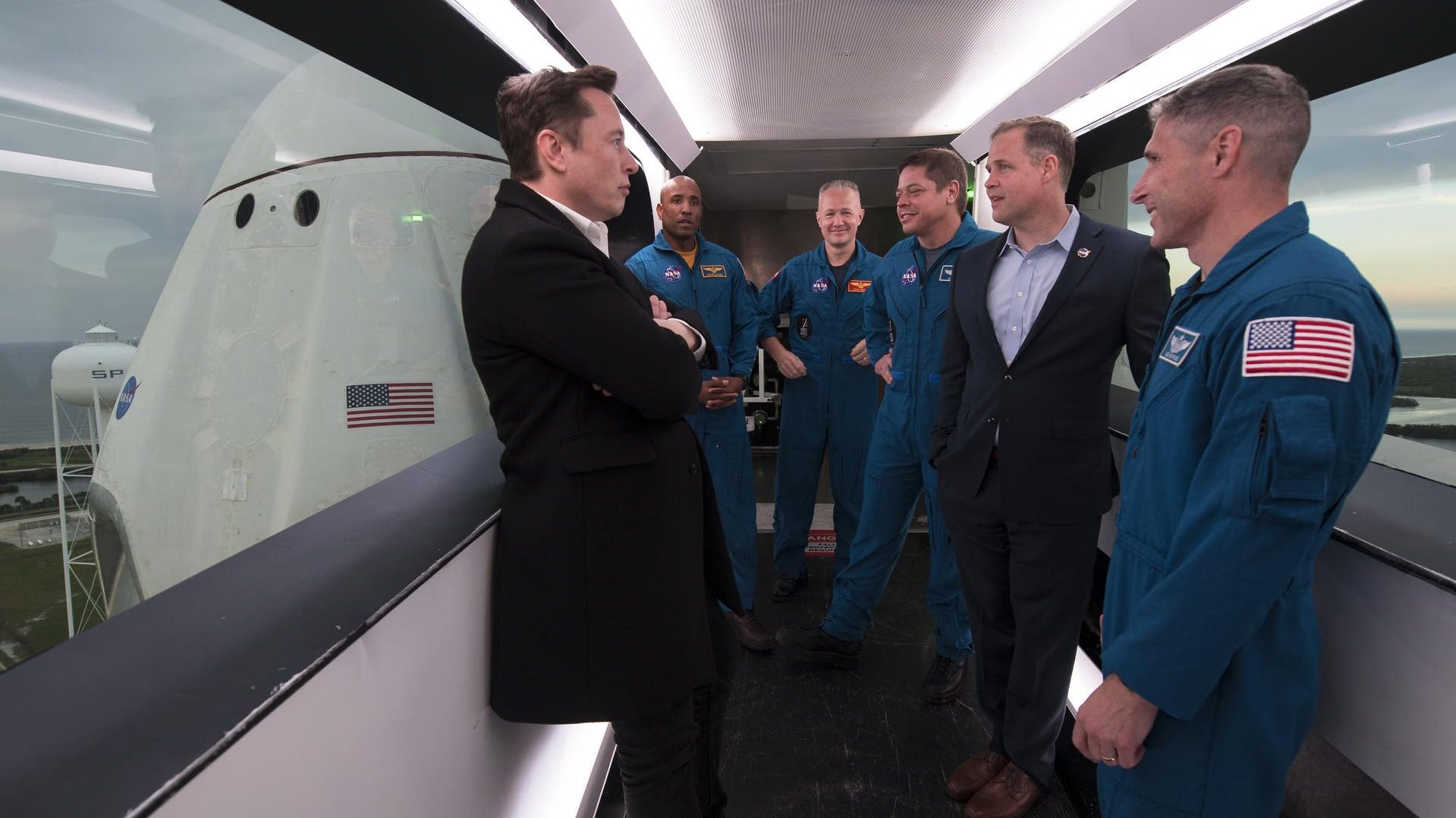 SpaceX CEO Elon Musk, left, speaks with NASA Admin