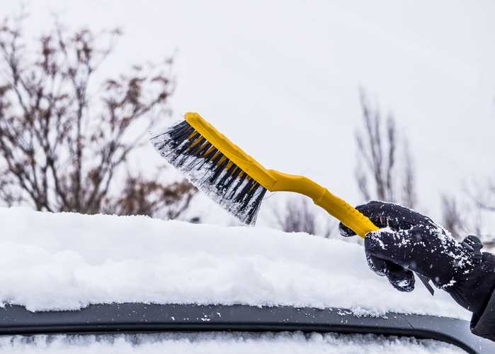 Car brush. Cleaning car from snow