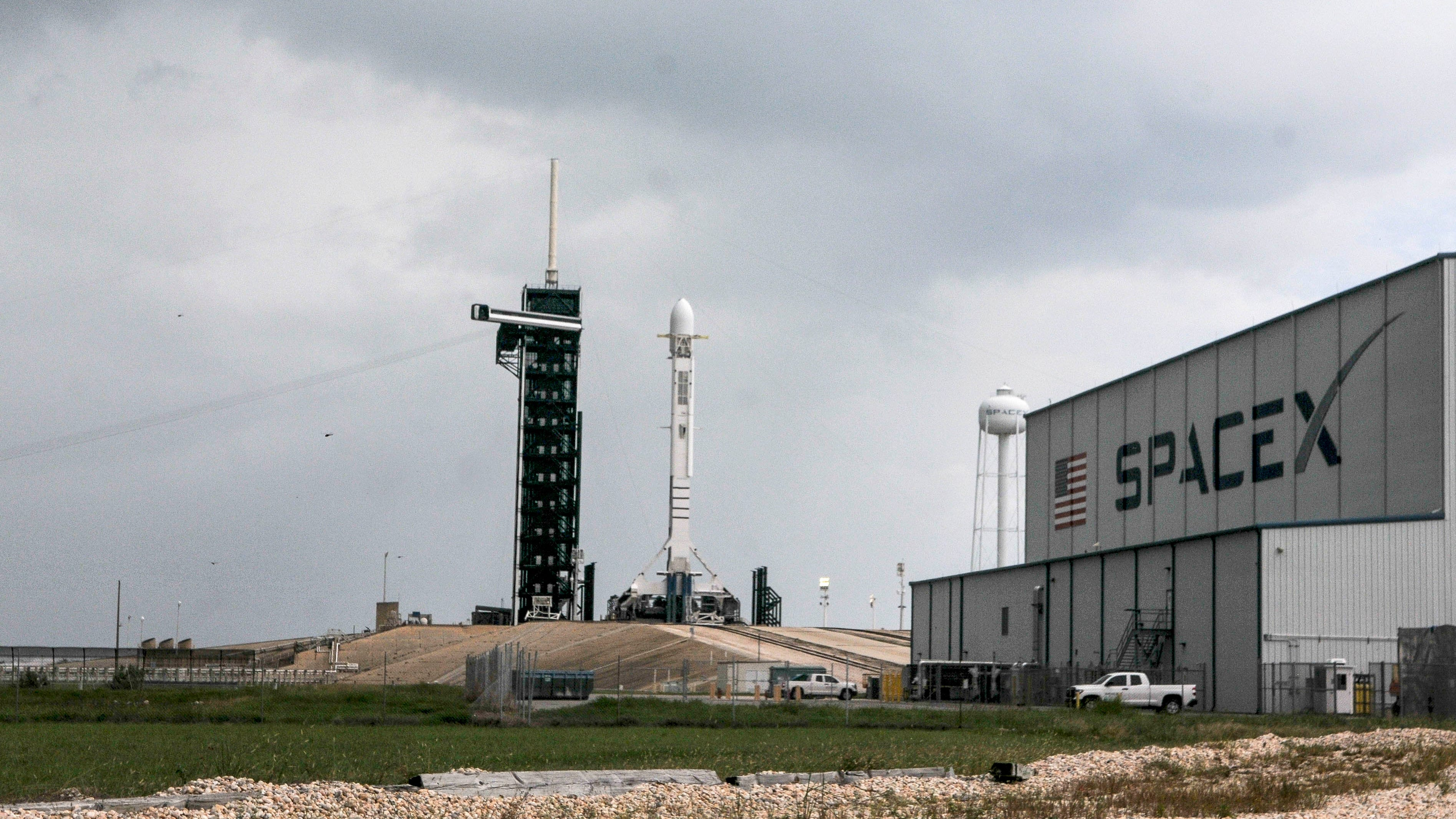 A SpaceX Falcon 9 rocket remains on Pad 39A at Ken