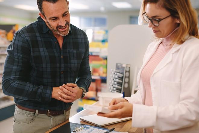 man talking to pharmacist