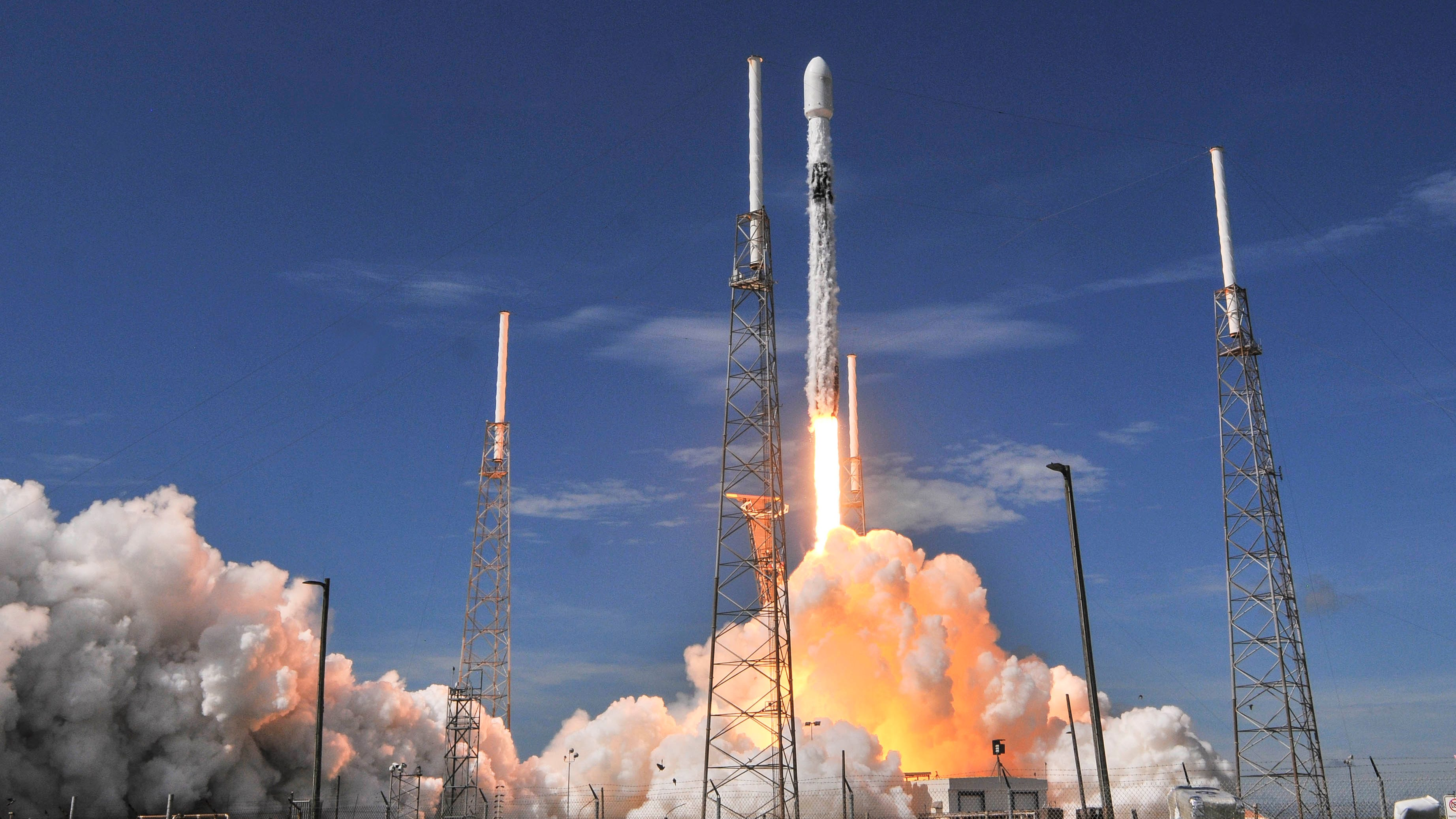 A SpaceX Falcon 9 rocket lifts off from Pad 40 at