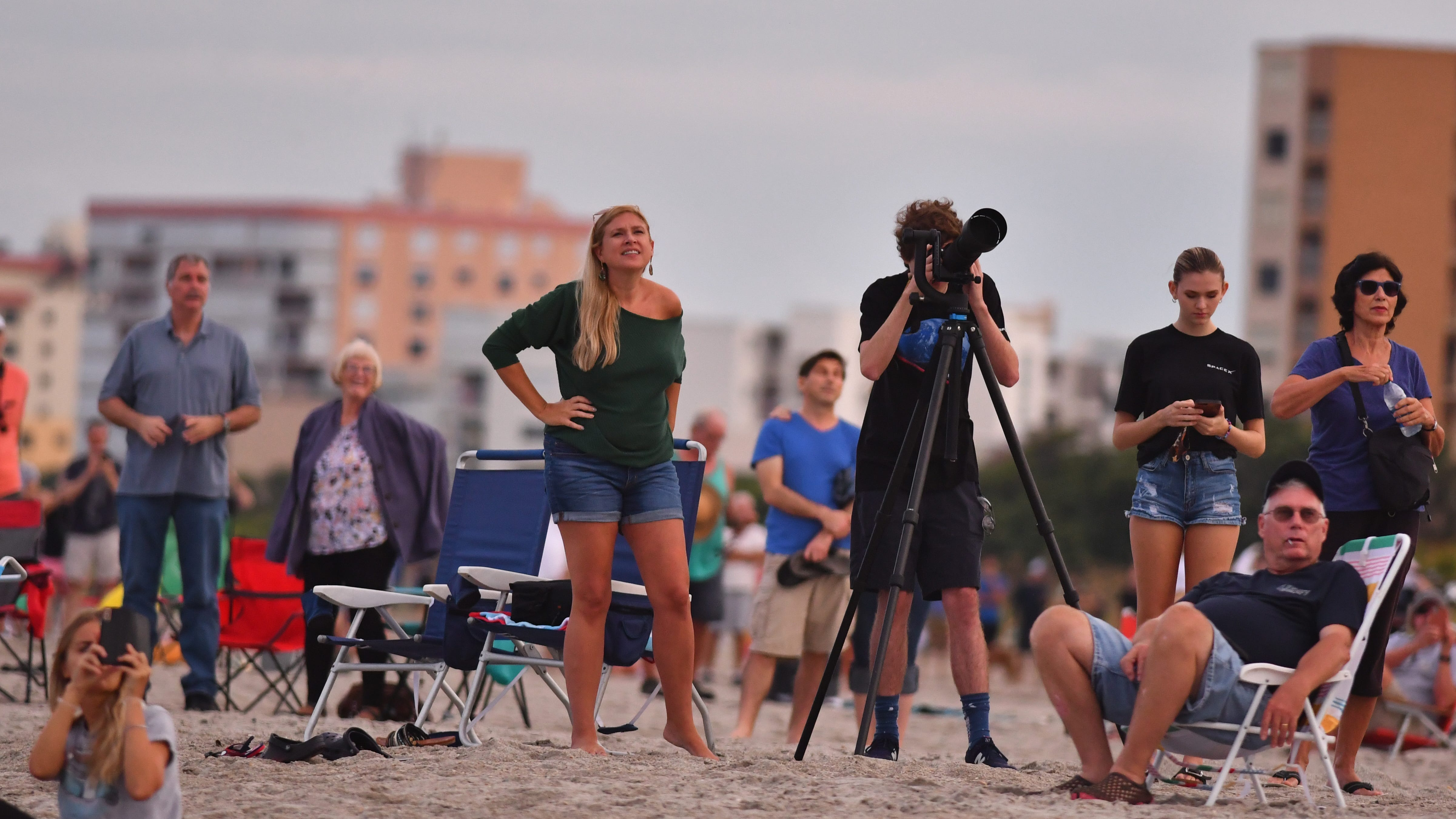 People at Cherie Down Park in Cape Canaveral watch the launch and booster landing of the SpaceX Falcon 9 rocket carrying an Argentinian communications satellite known as SAOCOM-1B. The rocket launched from Launch  Complex 40 at Cape Canaveral Air Force Station at 7:18 p.m. with booster landing about eight minutes later.