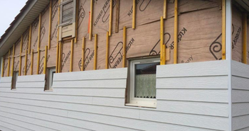 Insulating exterior walls from the outside effectively can be harder than it looks