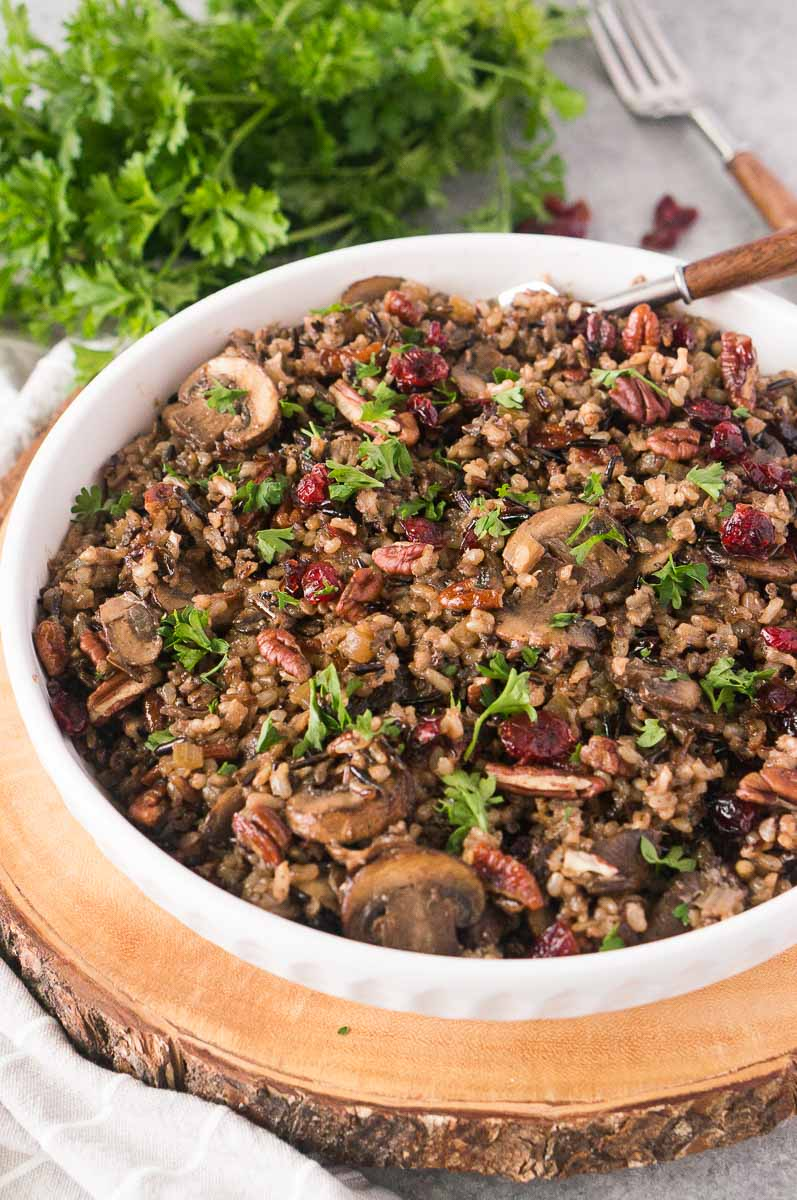 wild rice with mushrooms pilaf recipe in a white bowl