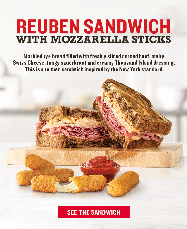 Reuben Sandwich With Mozzarella Sticks Marbled rye bread filled with freshly sliced corned beef, melty  Swiss Cheese, tangy sauerkraut and creamy Thousand Island dressing.  This is a reuben sandwich inspired by the New York standard.  SEE THE SANDWICH