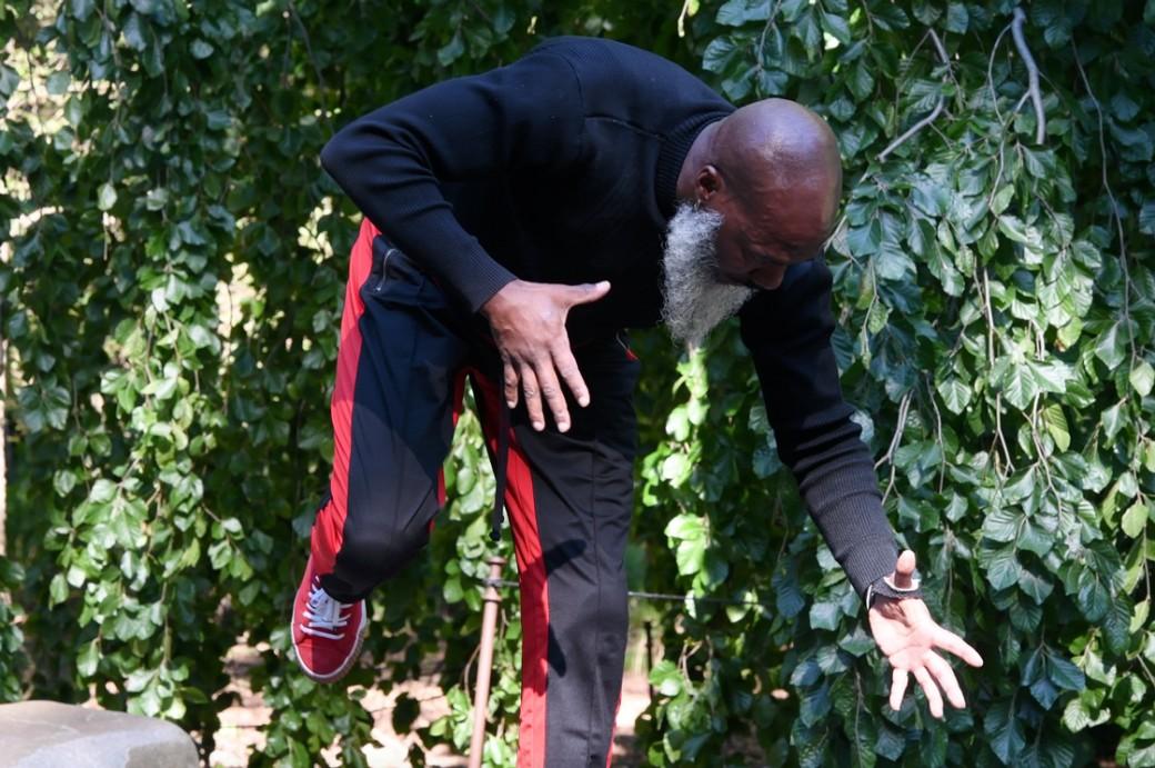 Man dancing in a garden