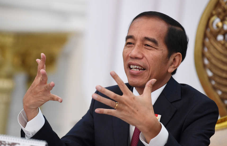 An animated President Joko Widodo addresses the press at the State Palace in Jakarta in June. (Antara Photo/Wahyu Putro A.)