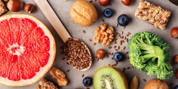 An assortment of fruits, vegetables, seeds, and nuts - Image
