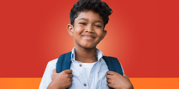 Young boy with backpack smiling