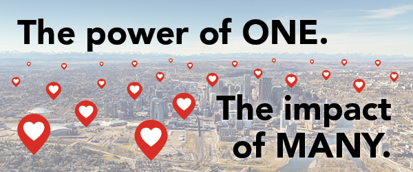 The power of one. The impact of many. An overview of a city with heart icons.
