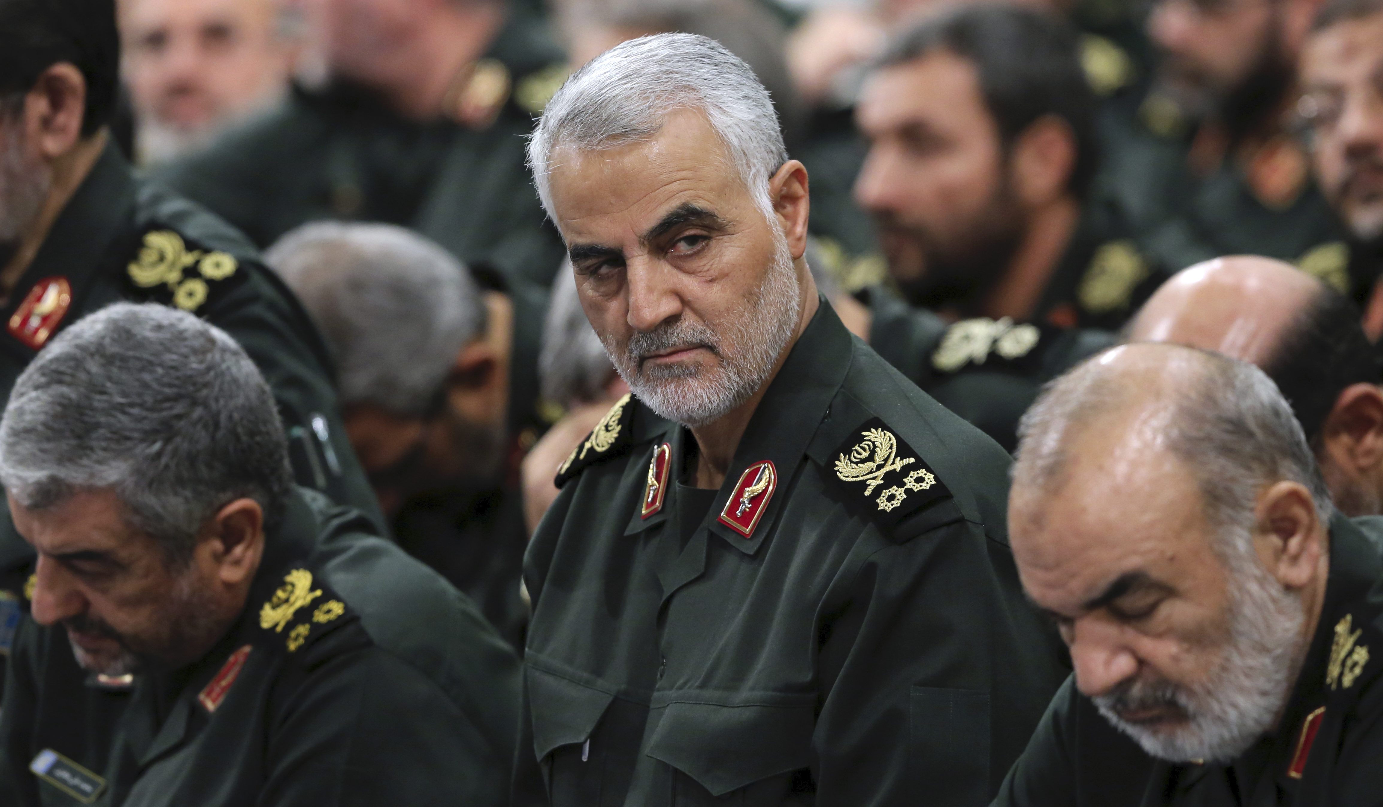 In this Sept. 18, 2016 photo, Revolutionary Guard Gen. Qassem Soleimani, center, attends a meeting with Supreme Leader Ayatollah Ali Khamenei and Revolutionary Guard commanders in Tehran, Iran.