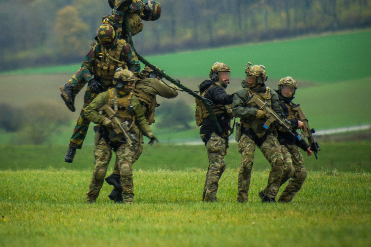 Combined troops from Austria, Belgium, Slovenia, and the United Kingdom take part in the BLACK BLADE 2016 helicopter exercise organized by the European Defense Agency, November 17, 2016.