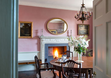 Roaring fire in the dining room at Belmont in Lyme Regis, Dorset