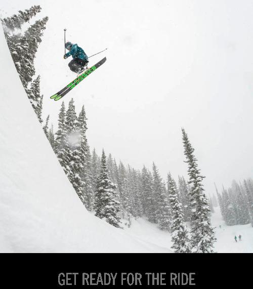 Skier doing 360 off drop