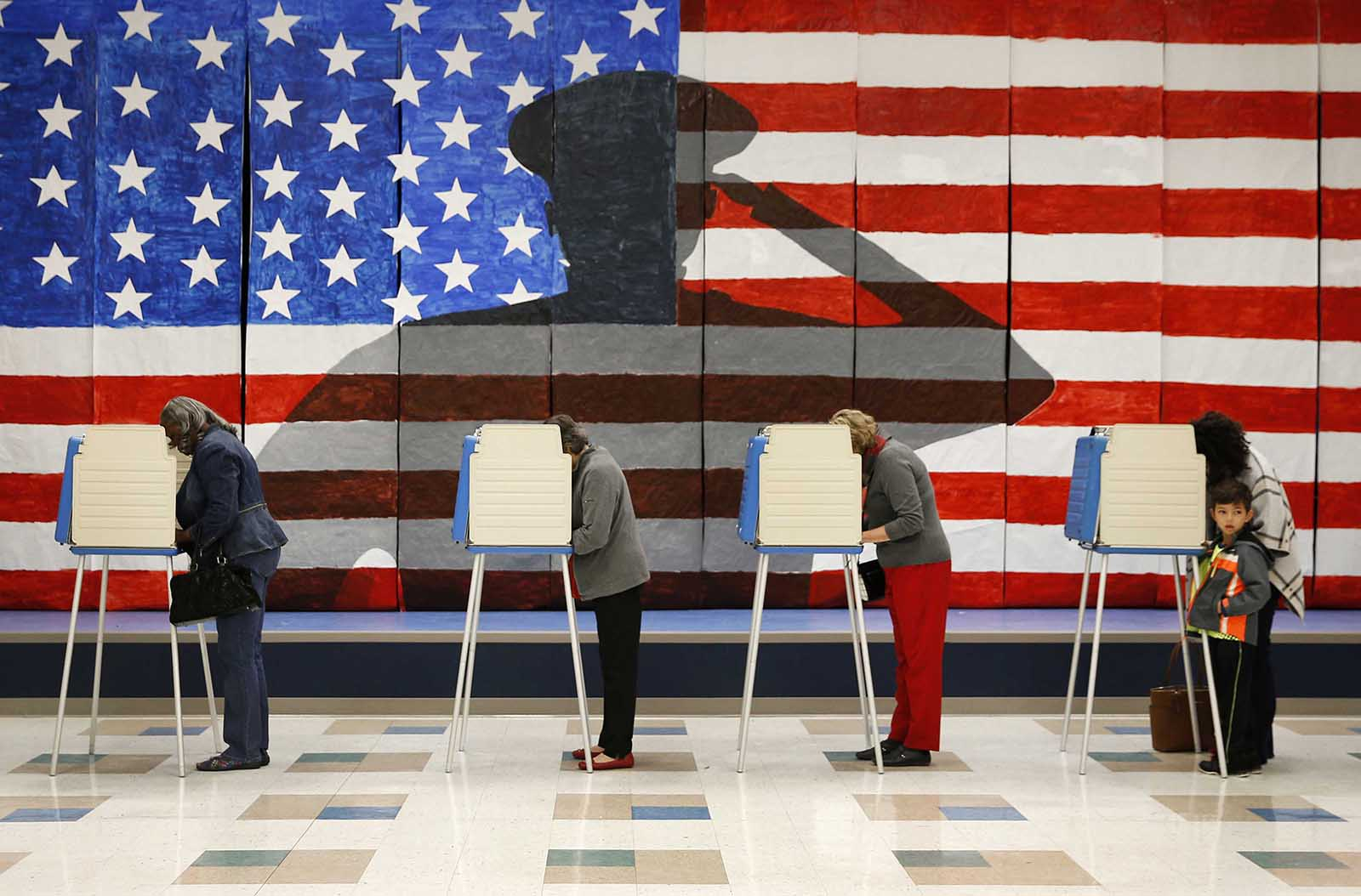 Voters line up to cast their ballots at Robious Elementary School in Richmond, Va. on Nov. 8, 2016. The mural in the background was painted by 3rd and 4th graders at the school in preparation for Veterans Day.