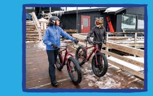 Two women ready to go biking with their fat tire bikes.