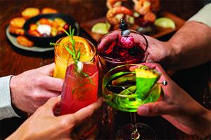 People cheersing for Cocktail Week