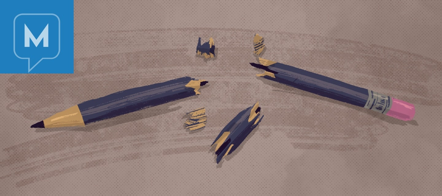 A violently snapped pencil with shards around it. frustration, anger, annoyed