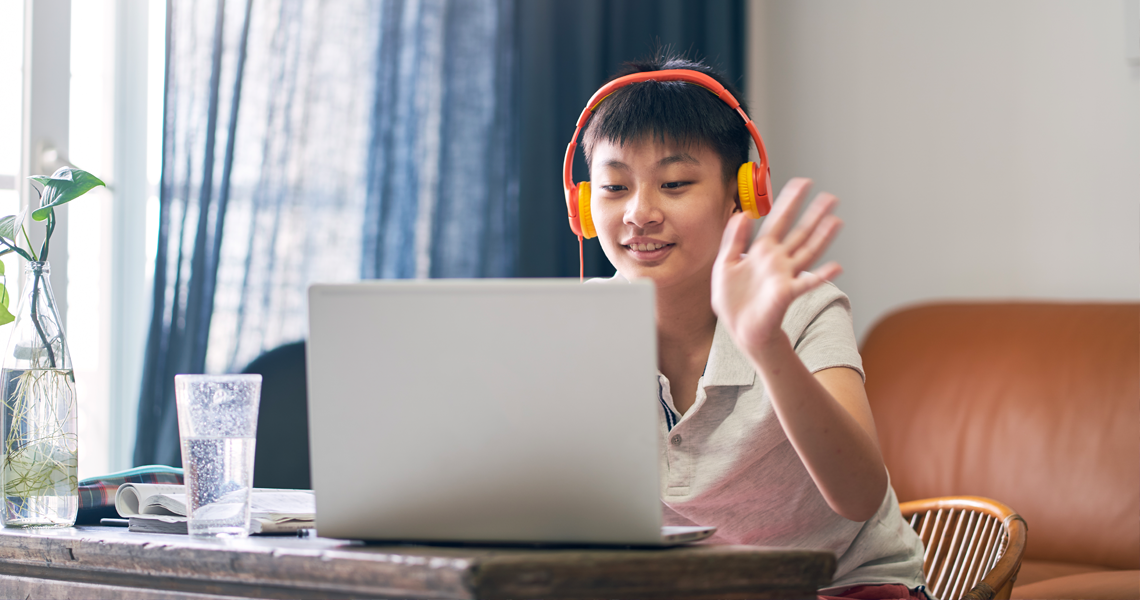 student listening at computer