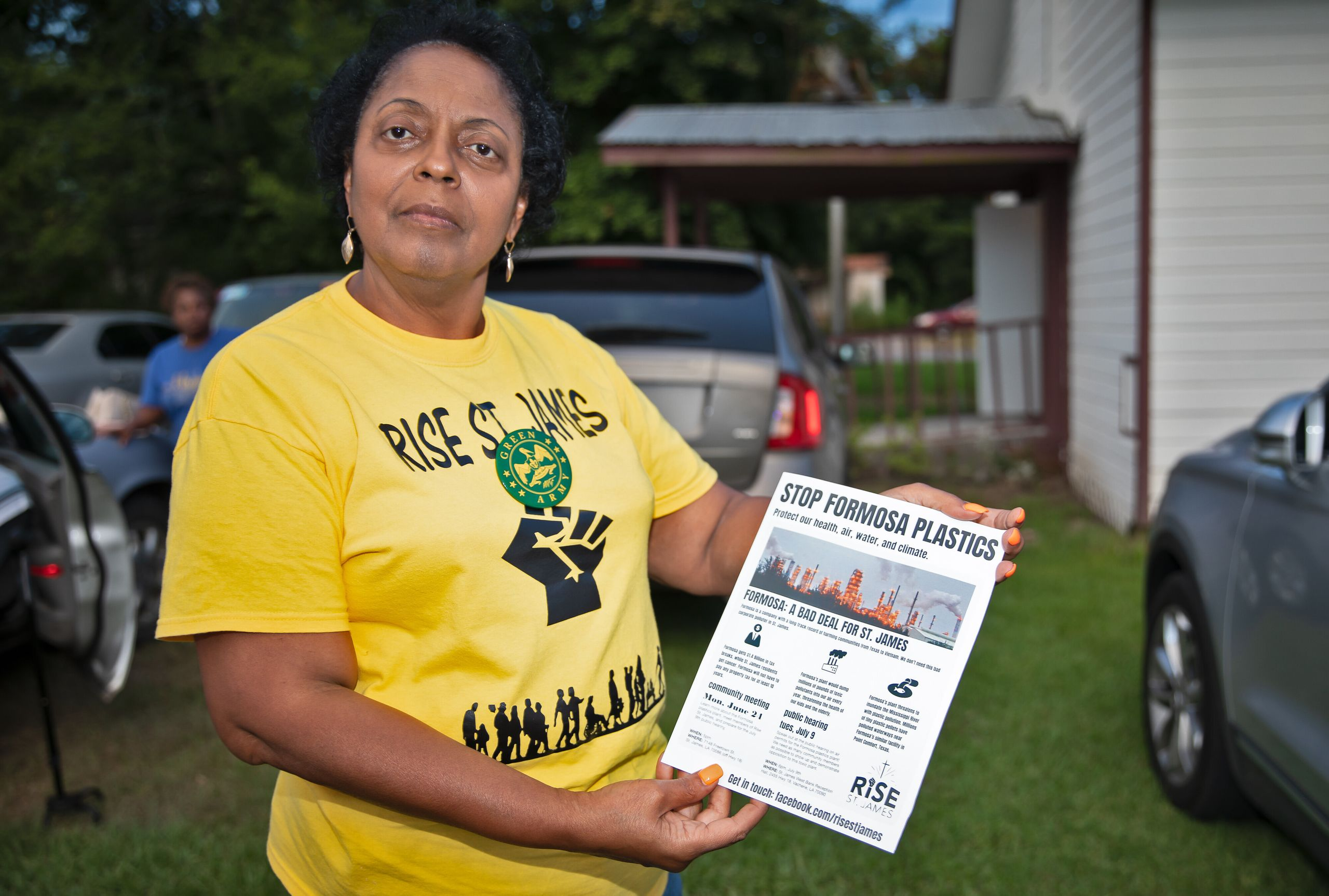Sharon Lavinge founder of RISE St. James in front of the Mt. Triumph Baptist Church with a flyer about the proposed Formosa plant