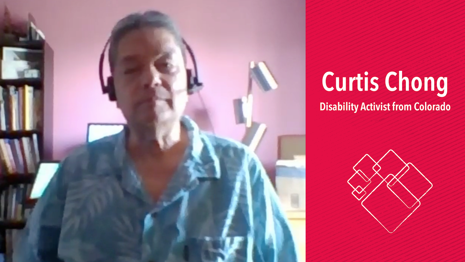 Curtis, an Asian American, looks to the web camera and wears a head set