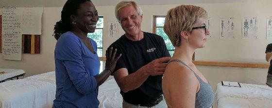 Man teaching two women