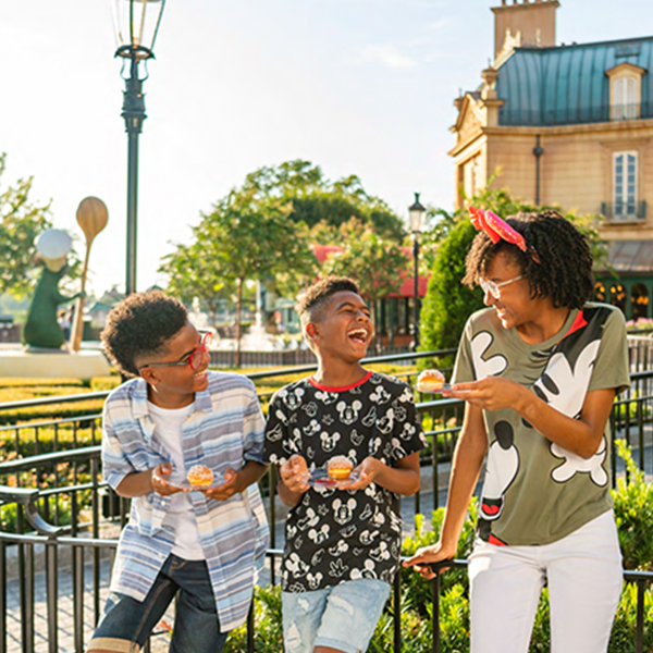 A mom and her two sons enjoy some light bites in France during the Taste of EPCOT International Food & Wine Festival.