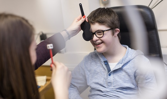 Boy with glasses having sight test