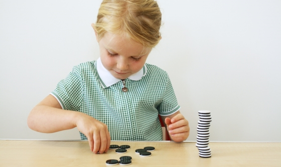 School girl working with counters