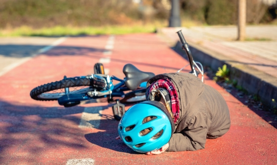 Boy who's fallen off bike and hit his head