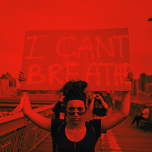 woman holding a sign reading i can''t breathe