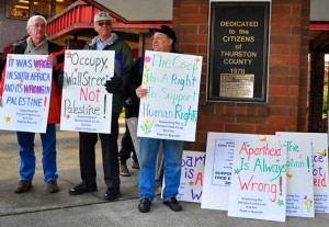 protesters from olympia co-op seen holding signs supporting palestinian rights and the right to free speech