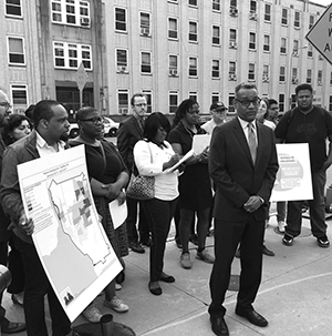 Executive director Vince Warren stands in front of group of Buffalo activists