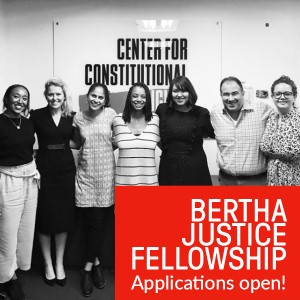 black and white image of seven people smiling back at the camera atop a red rectangle is white text that says bertha justice fellowship applications open