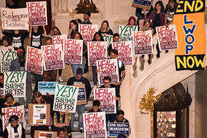 Protesters holding signs, Photo credit: ''Rally in PA Capitol to end death by incarceration'' by joepiette2 is licensed under CC BY-NC-SA 2.0