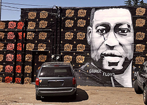 photo of a mural in portland oregon depicting george floyd with roses courtesy of wiredforlego
