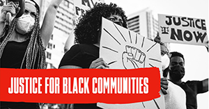 image of a protester holding a sign with a black power fist the text rads justice for black communities