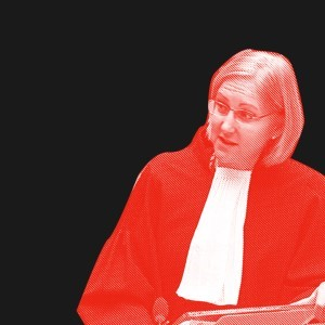 senior staff attorney katherine gallagher is seen at the ICC with a red filter over a dark background