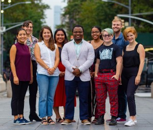 Group of Ella Baker interns smiling and looking at the camera while standing under the arc at washington square park