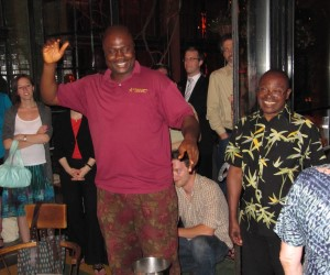 an image of human rights activist patrick naagbanton. he is seen wearing a red polo shirt and patterned shorts, dancing and enjoying himself at a gathering